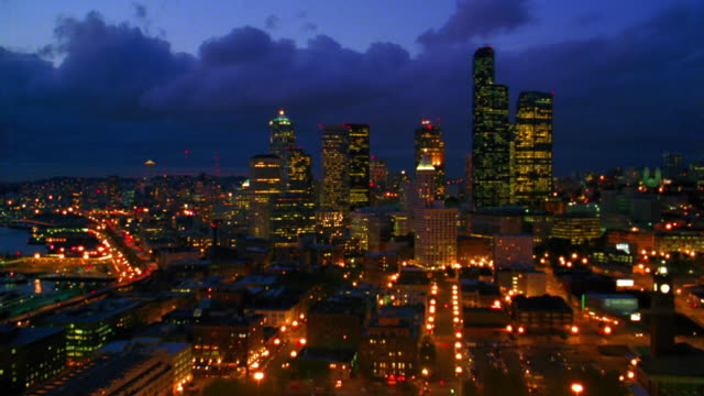 aerial point of view toward and over kingdome then over downtown seattle at night / washington - 北アメリカ点の映像素材/bロール