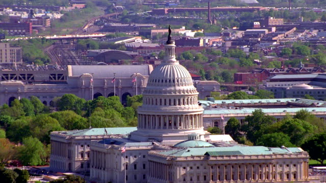 Aerial point of view zoom in and zoom out Capitol Building with Union Station in background / Washington D.C.
