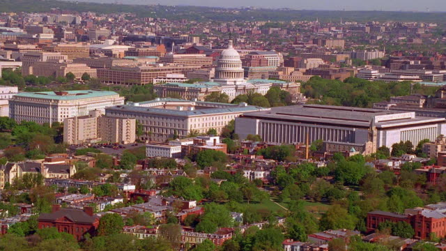 Aerial point of view zoom in Capitol building and Washington D.C.