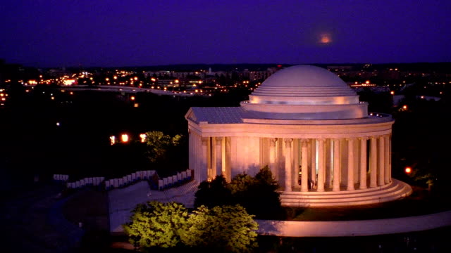 aerial point of view  zoom out from jefferson statue to circling jefferson memorial at night / washington d.c. - jefferson memorial stock videos & royalty-free footage