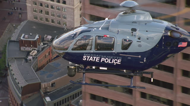 aerial police copter low over city buildings, boston - boston massachusetts stock videos & royalty-free footage
