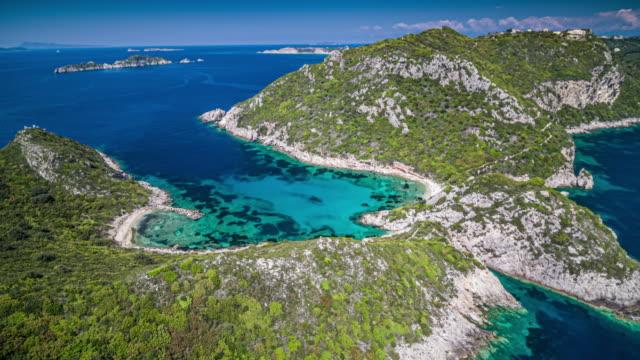 aerial: porto timoni beach in corfu, greece - lagoon stock videos & royalty-free footage
