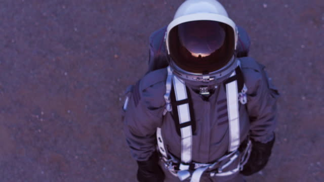 aerial portrait of astronaut in space suit - oxygen tank stock videos and b-roll footage