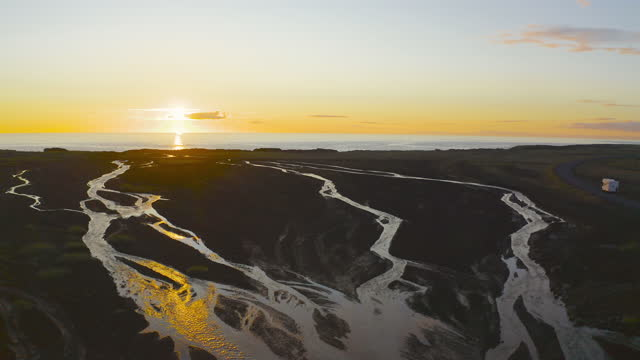 aerial, pov, a golden sunset over the horizon outside of reykjavik, iceland - 円光点の映像素材/bロール