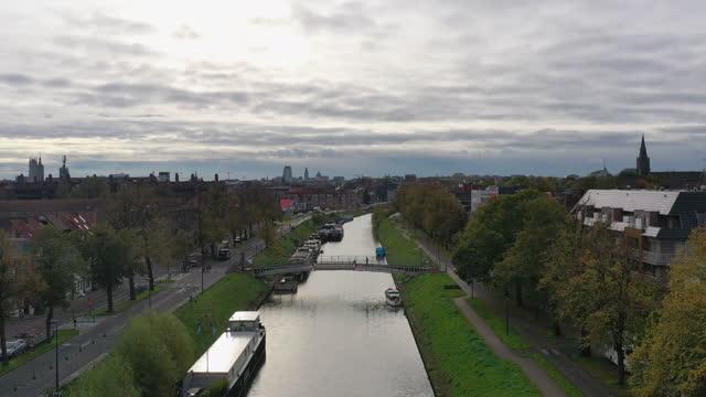 aerial, pov, a treelined canal and gent cityscape, belgium - overcast bildbanksvideor och videomaterial från bakom kulisserna