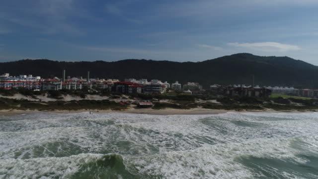 vídeos y material grabado en eventos de stock de aerial - praia dos ingleses - praia