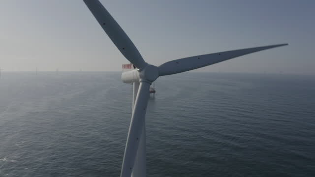 aerial cu propellors of offshore wind turbine - propeller stock videos & royalty-free footage
