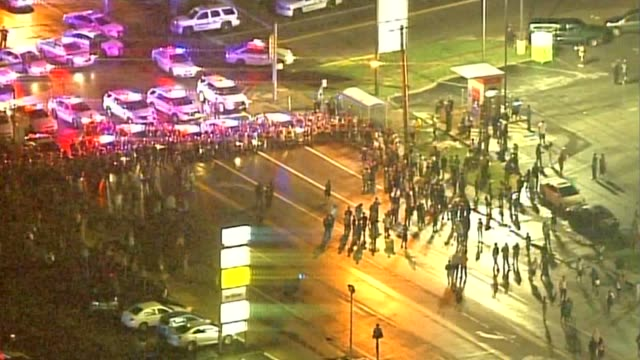 ktvi aerial protestors face line of police officers at mike brown shooting anniversary protest on august 9 2015 in ferguson missouri - st. louis missouri stock videos & royalty-free footage