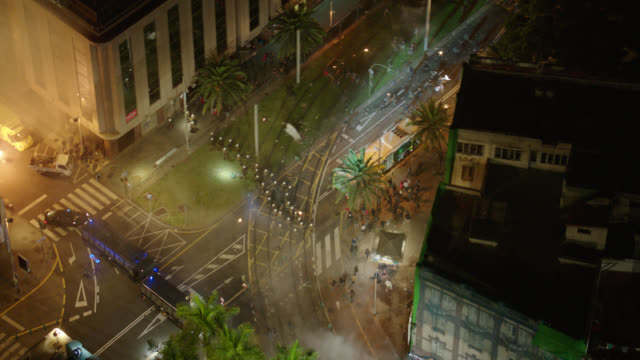 aerial protestors riot on city streets (athens, greece, cba) - night - athens greece stock videos & royalty-free footage