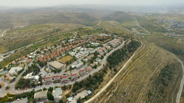 aerial / psagot an israeli settlement in the west bank - human settlement stock videos & royalty-free footage