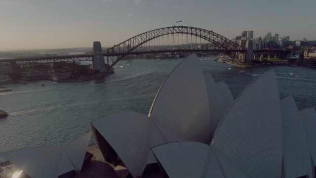 Aerial pull back of the Sydney Opera House and the Sydney Harbour Bridge. Sydney Australia