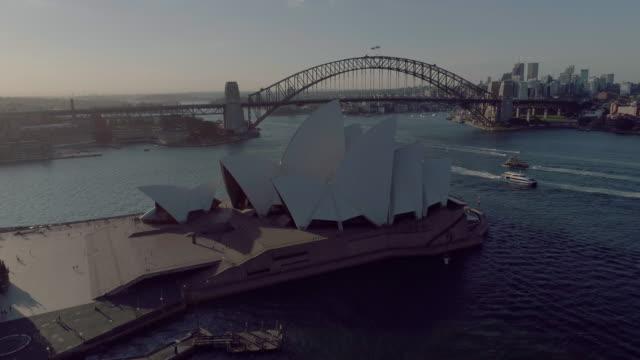 Aerial pull back to reveal the Sydney Opera House. Sydney Australia