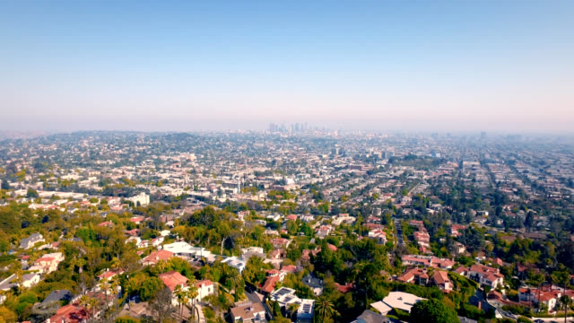 Aerial pull downtown Los Angeles skyline and the massive size of Los Angeles.