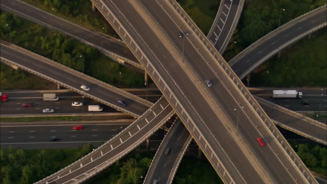 Aerial pulling out from M25 junction with M23 / Surrey, England