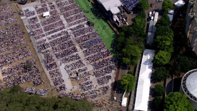 aerial pull-out from flushing meadows crowd - artbeats stock videos & royalty-free footage