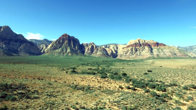 aerial push of red rock canyon in nevada. - red rocks stock videos & royalty-free footage