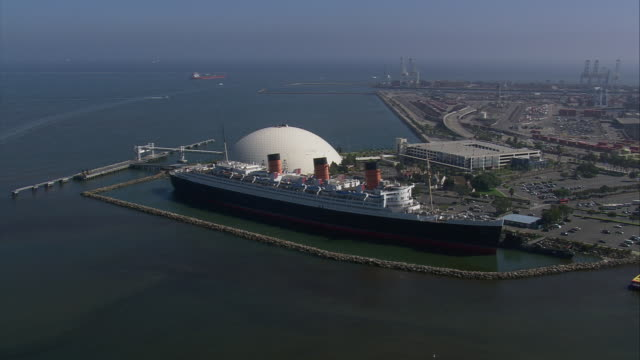 aerial ts ms queen mary  and planetarium / long beach, california, united states - long beach california stock videos & royalty-free footage