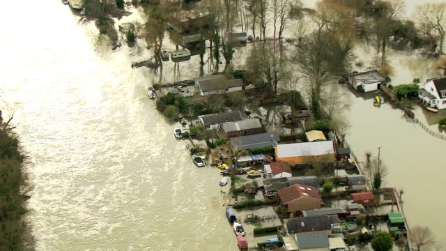 aerial rain stormy weather river flooding england uk - inondazione video stock e b–roll