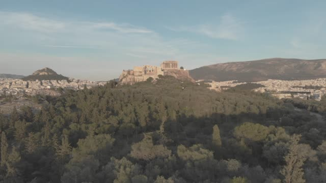Aerial raw footage - Athens - Greece - close view of the Acropolis from a hill full of trees