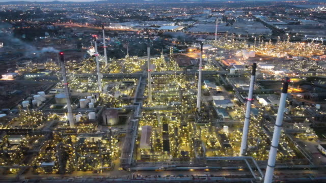 4k aerial realtime video flying above oil refinery storage tank of crude oil and petrochemical industrial background of oil and gas refinery factory in south east asia - saudi arabia stock videos & royalty-free footage