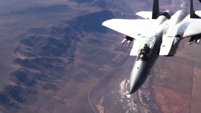 aerial refuel of f-15 eagle by kc-135 stratotanker - us airforce stock videos & royalty-free footage