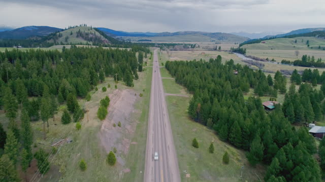aerial remote view toward rocky mountain and lewis and clark national forest, and salmon lake state park, along the highway mt 200 near greenough, montana, in early spring. stormy weather. - pick up truck stock videos & royalty-free footage