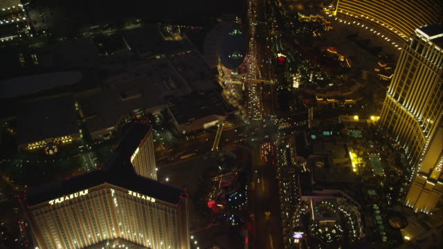 aerial reveal las vegas strip at night - the strip las vegas stock videos & royalty-free footage