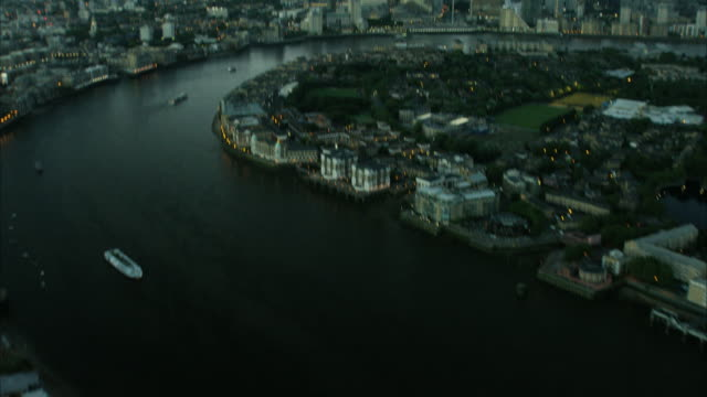 aerial reveal night view of buildings london uk - london docklands stock videos & royalty-free footage
