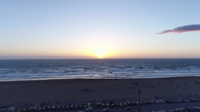 aerial reveal of a sunset on the beach - superwoman stock videos and b-roll footage