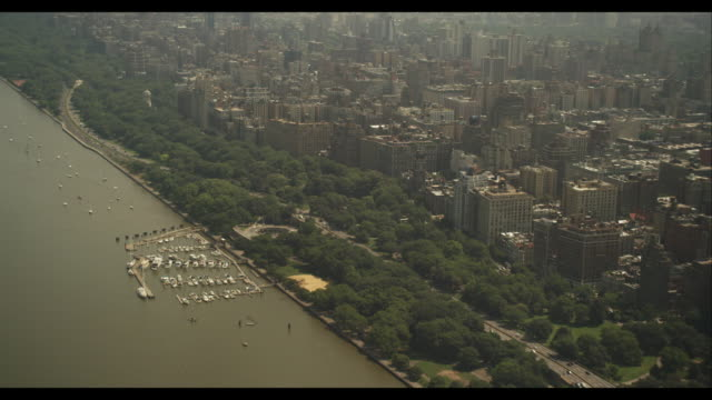 aerial reveal of bronx from over hudson river - bronx new york stock videos and b-roll footage