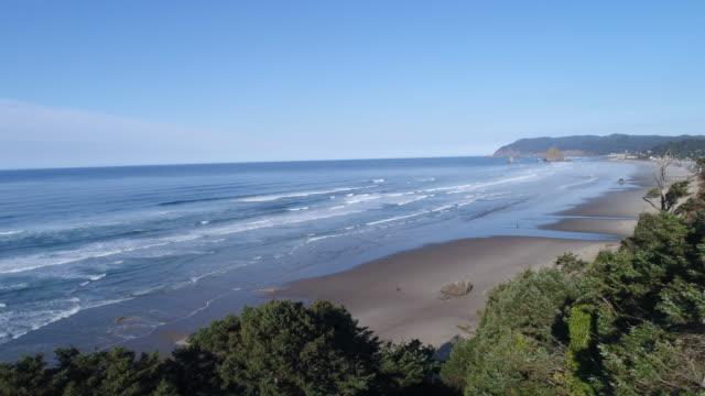 aerial reveal of canon beach, oregon - haystack rock stock videos & royalty-free footage