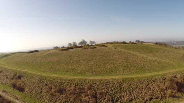 aerial reveal of cissbury ring iron age hillfort - ring stock videos and b-roll footage