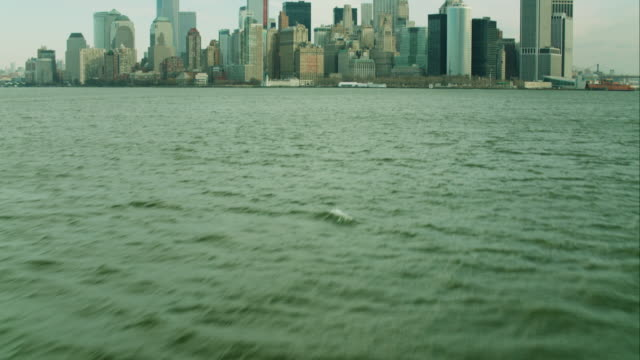 aerial reveal of downtown manhattan from water - film tilt stock videos & royalty-free footage