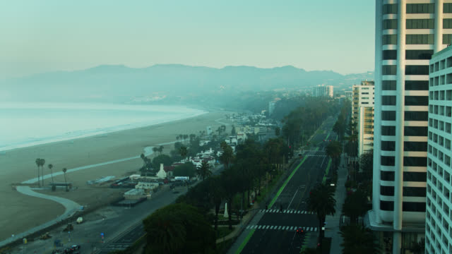 aerial reveal of pch and ocean ave on foggy morning in santa monica during covid-19 lockdown - santa monica street stock videos & royalty-free footage