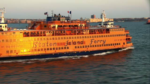 Aerial Reveal of Staten Island Ferry over Water