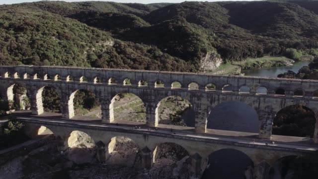 aerial reveal of the pont du gard, france - roman stock videos and b-roll footage