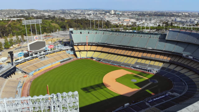 aerial reveal of unfilled stadium due to covid-19 pandemic. - western usa stock videos & royalty-free footage