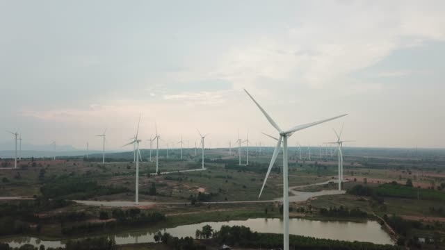 Aerial reveal of Windmill in wind farm