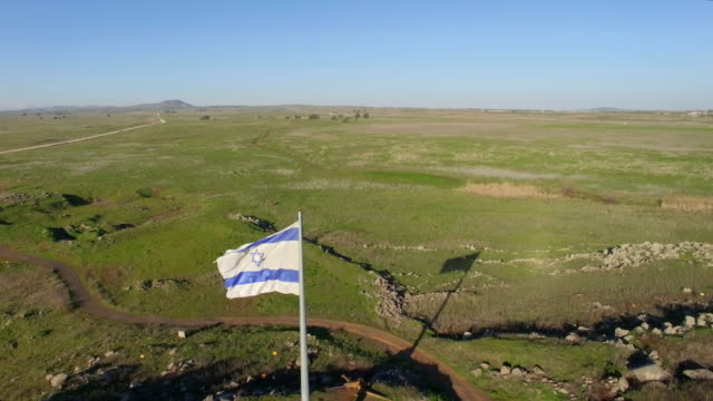 Aerial Revealing /Israel flag with the Golan heights in background