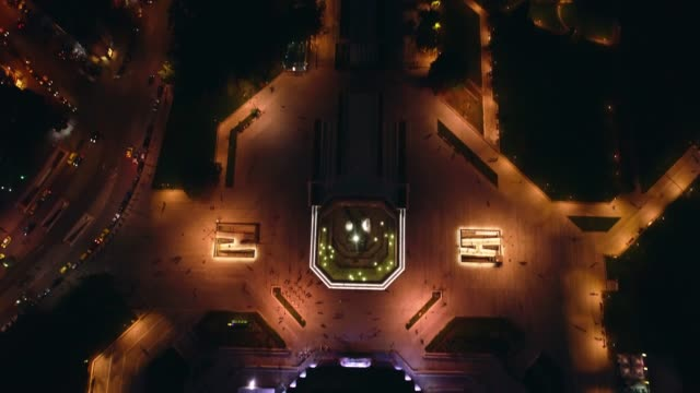 Aerial revealing shot of downtown district in Sofia, Bulgaria at night