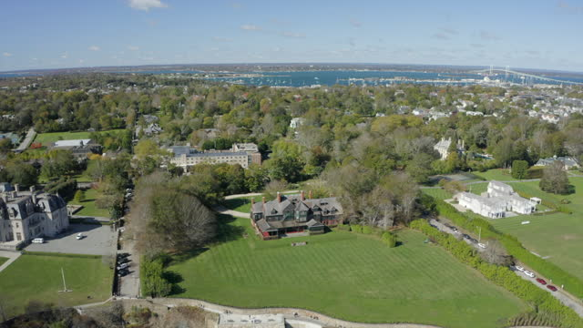 aerial reversing high above a famous newport mansion on a bright, sunny way with the town and bay on the horizon - cultures stock videos & royalty-free footage