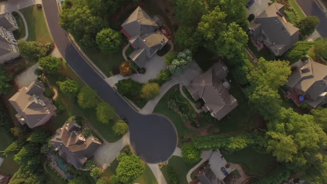 4K Aerial Rich NEIGHBORHOOD down - drone aerial video city views in 4k beautiful reveal with traffic and homes in view