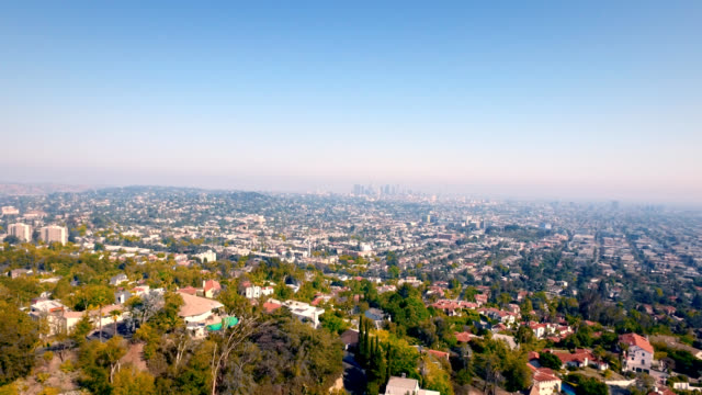 Aerial right to left of downtown Los Angeles skyline and the massive size of Los Angeles.