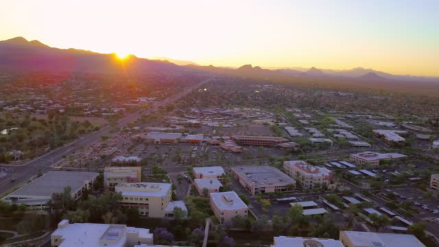 aerial right to left: sun hiding behind mountains - arizona stock videos & royalty-free footage