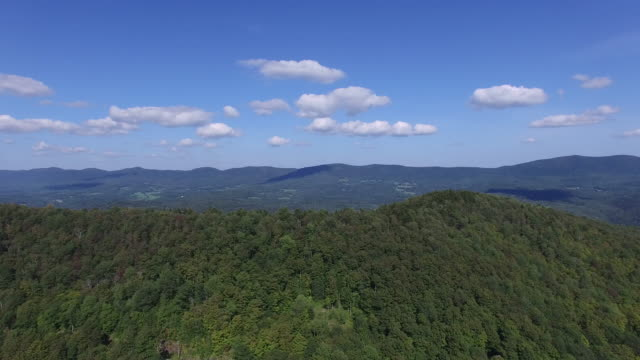 4K aerial rising above the Green Mountains in Vermont, USA