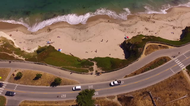 aerial rising from tree, reveals coastline - major road stock videos & royalty-free footage