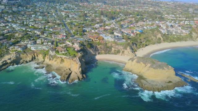 aerial rising: homes on cliff in laguna beach - laguna beach california stock videos & royalty-free footage