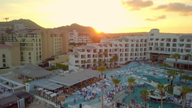 aerial rising: people at the resort and the sunset - cabo san lucas stock videos & royalty-free footage