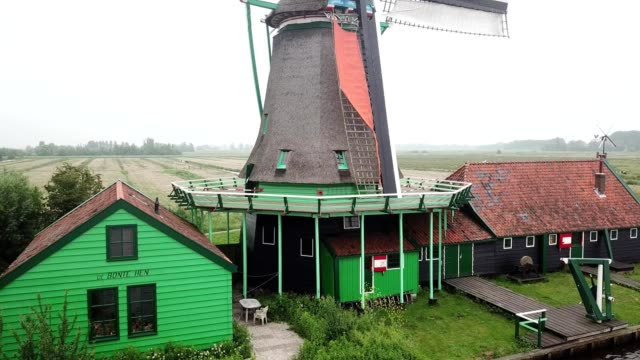 aerial rising view of a windmill in zaandam noord-holland netherlands - amsterdam stock videos & royalty-free footage