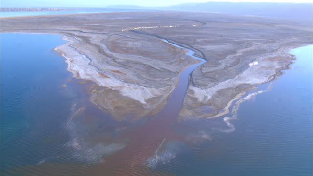 aerial river flowing in to the dead sea in the judea desert. sediments and deposits in delta clearly visible, israel - delta stock videos and b-roll footage
